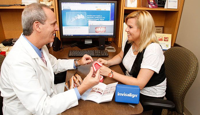 Doctor showing patient how invisalign works.