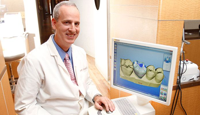 Doctor using the CEREC system