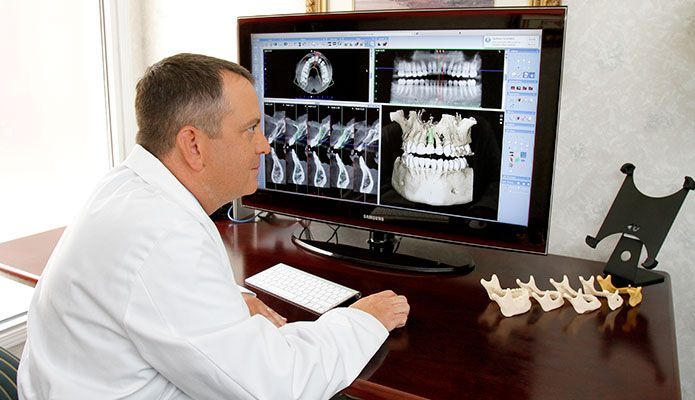 Doctor evaluating CT scan.