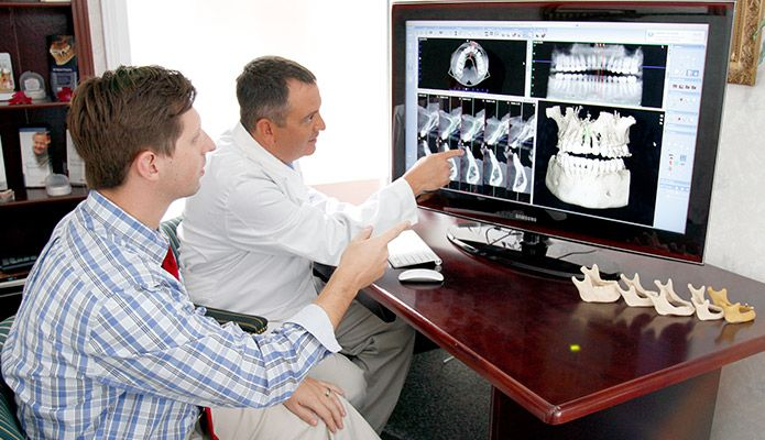 Doctor looking at 3D scan of teeth.
